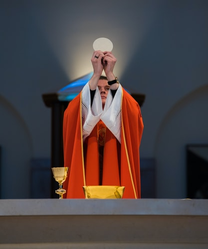 Priest with the Eucharist